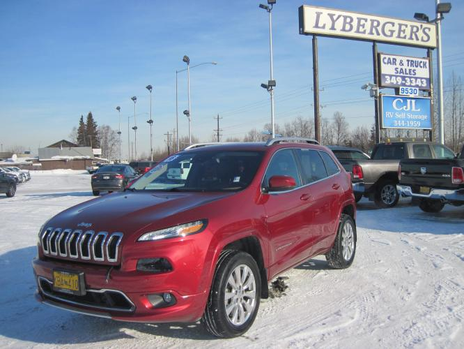 2016 maroon /black Jeep Cherokee Overland 4WD (1C4PJMJS1GW) with an 3.2L V6 DOHC 24V engine, 9A transmission, located at 9530 Old Seward Highway, Anchorage, AK, 99515, (907) 349-3343, 61.134140, -149.865570 - Photo #0