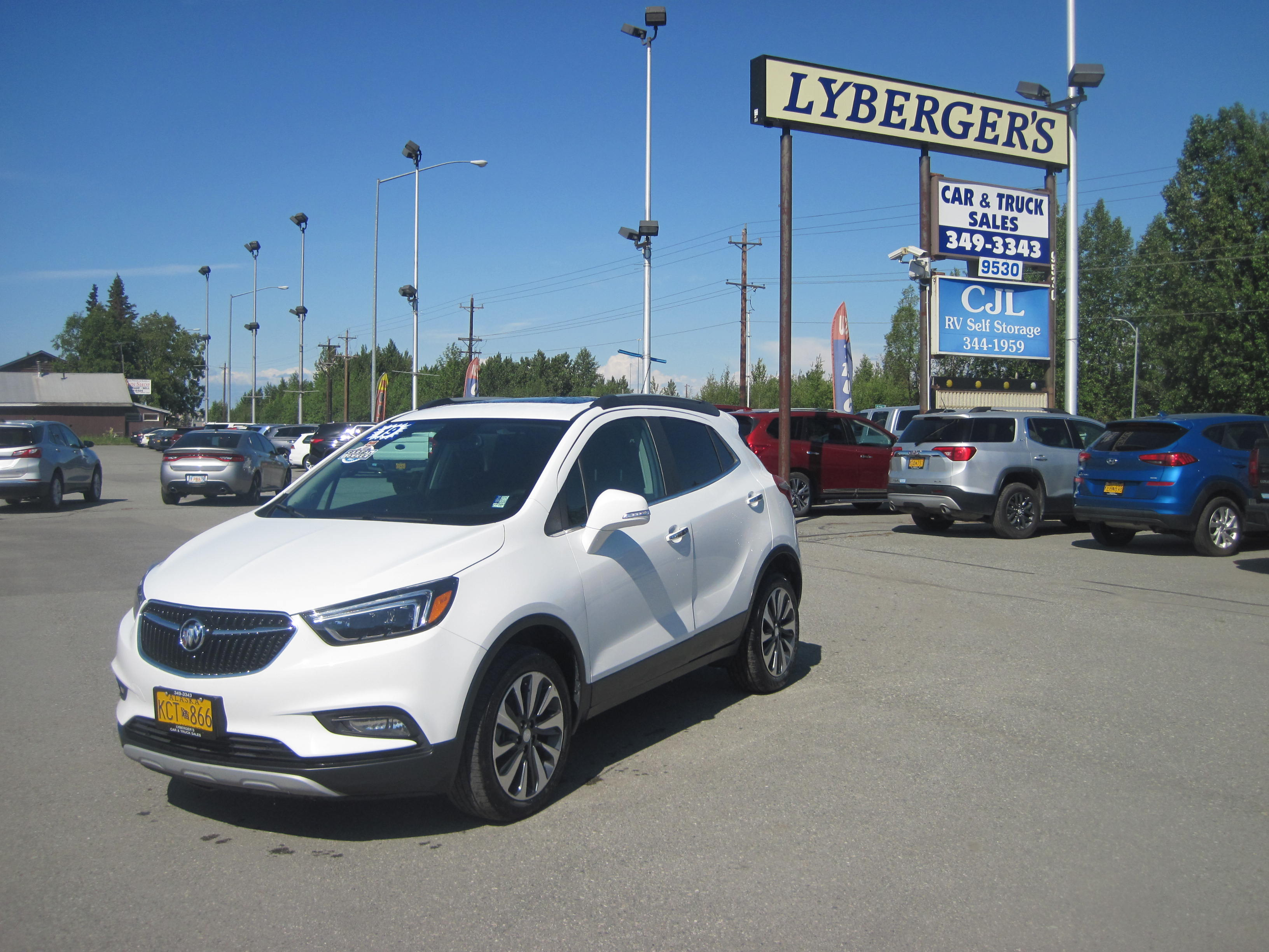 2019 white /black Buick Encore Essence AWD (KL4CJGSM3KB) with an 1.4L L4 DOHC 16V TURBO engine, 6A transmission, located at 9530 Old Seward Highway, Anchorage, AK, 99515, (907) 349-3343, 61.134140, -149.865570 - Photo #0
